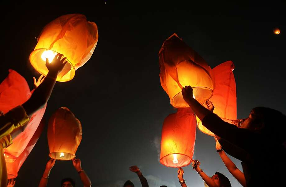 Volunteers release hot-air lanterns into the air to promote a peaceful and eco-friendly Diwali Festival of Lights in Kolkata, India. The group was also protesting child labor in the firecracker industry. Photo: Dibyangshu Sarkar, AFP/Getty Images