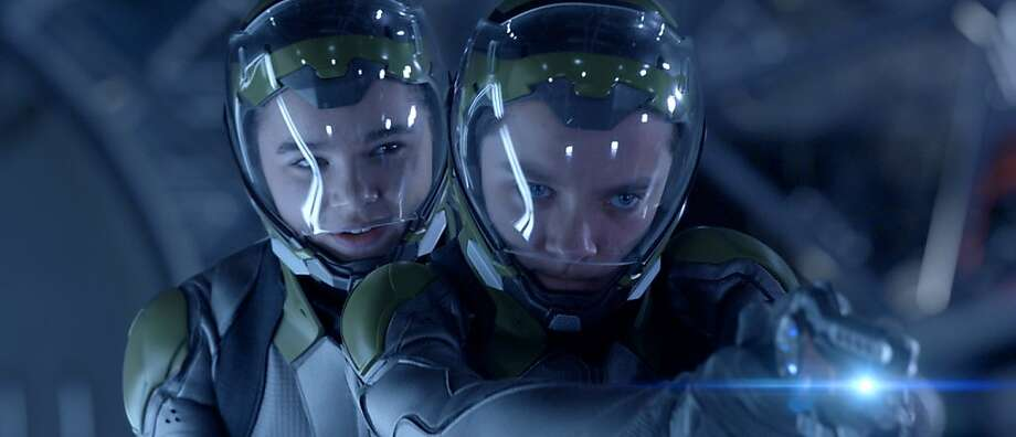 """Hailee Steinfeld (left) and Asa Butterfield play cadets at Battle School, preparing for an invasion of Earth by antlike creatures in the science-fiction adventure """"Ender's Game,"""" based on Orson Scott Card's novel. Photo: Courtesy: Summit Entertainment, Summit Entertainment"""