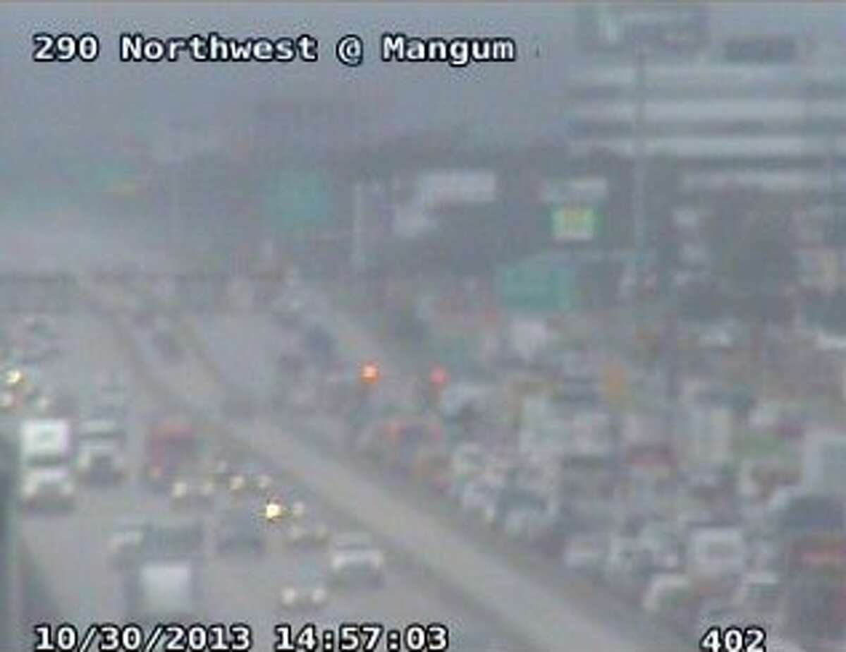 A wreck on US 290 has shut down all westbound main lanes at 34th street. (Houston Transtar photo)