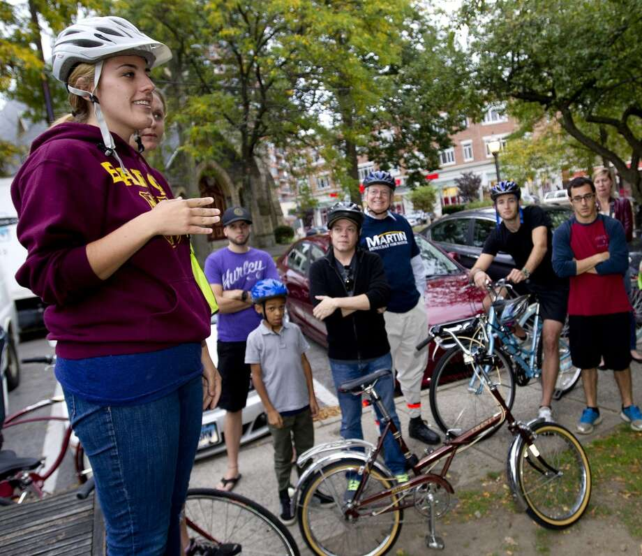 Organizers Meg Dalton and Andrea Banty review the planned route as cyclists gather at Latham Park in Stamford, Conn., on Friday, October 11, 2013, for Bike Stamford, an event to raise awareness and encourage bicycling. Photo: Lindsay Perry
