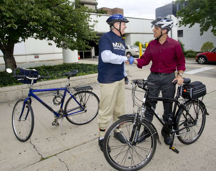 Stamford mayoral candidate David Martin rides his bike through downtown Stamford with Mike Norris, founder of diybiking.com, on Thursday, Sept. 5, 2013. Norris has been taking all the candidates on rides during rush hour to raise awareness of travel from a bicyclist's perspective. Photo: Lindsay Perry