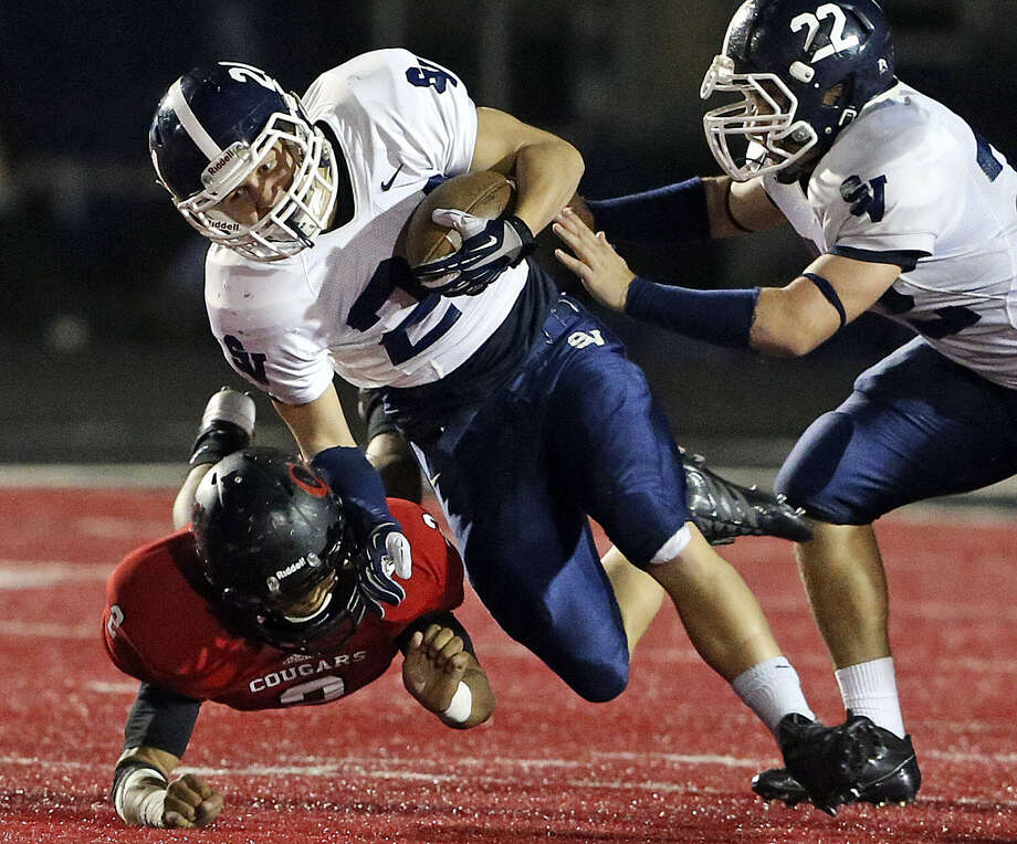 Ranger running back Cord Given escapes Cougar linebacker Eric Rodriguez as he takes the ball up field in the second half Friday at Canyon High School Stadium. The Rangers won in their 11th straight victory. Photo: Tom Reel / San Antonio Express-News