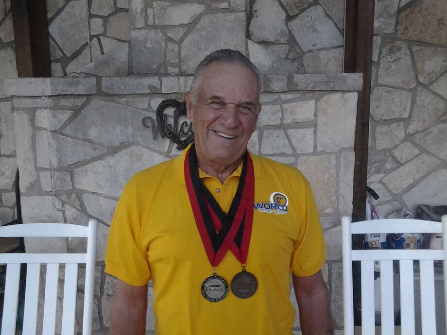 Dick Howell, a Hunt resident, won the silver medal in age 75-plus pickleball singles and teamed with Utah's Frank Feltner to earn the bronze medal in men's doubles at the 27th Huntsman World Senior Games in St. George, Utah, in October of 2013. The Games are the largest annual multisport event in the world for athletes over 50. Photo: Courtesy Photo