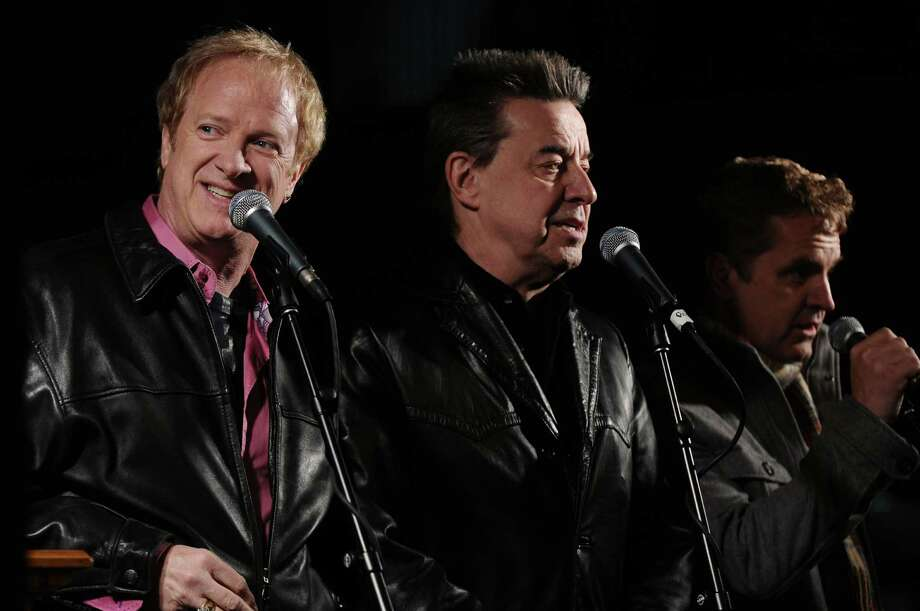 State Street was rededicated as Chicago band members, including Lee Loughnane, left, Walt Parazaider, center, and Jason Scheff, right,  sang Christmas songs acapella during a ceremony on Thursday evening Dec. 1, 2011 in Albany, NY.   A short fireworks display followed, after the streets holiday lights were turned on .(Philip Kamrass / Times Union ) Photo: Philip Kamrass / 10015615A