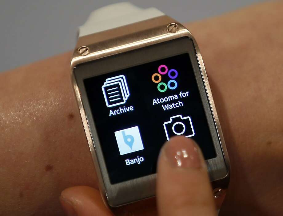 Samsung became the first major company to release a smartwatch in September when it unveiled the Galaxy Gear. The device only works with one Samsung phone, the Galaxy Note 3. Reviews of the device have said the combined cost -- $300 for the watch, $200 for the phone --may be too steep for some Samsung fans. In addition to its time-telling functions, Galaxy Gear can make phone calls, record a voice memo, and help wearers locate their Samsung phone. Photo: Michael Sohn, Associated Press