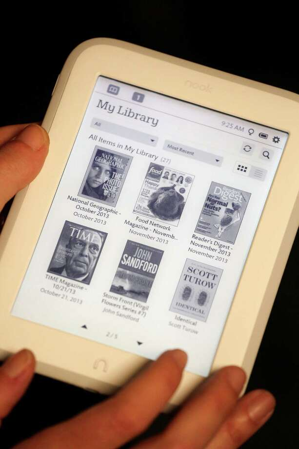 "In this Monday, Oct. 28, 2013 photo, The ""My Library"" page is selected on Barnes & Noble's new e-reader, Nook GlowLight, during a demonstration in New York. The e-reader is available in its retail stores and online starting Wednesday, Oct. 30,  for $119. (AP Photo/Mark Lennihan) ORG XMIT: NYML104 Photo: Mark Lennihan / AP"