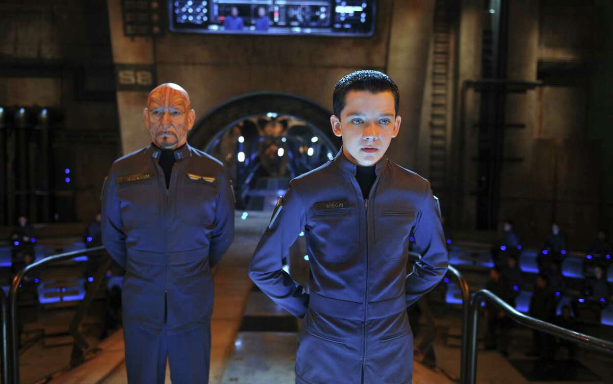 Ender Wiggin (Asa Butterfield, right) must lead the charge against alien invaders, just as his predecessor (Ben Kingsley) did.