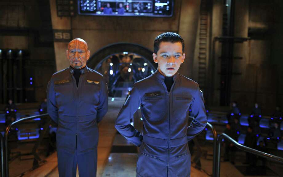 Ender Wiggin (Asa Butterfield, right) must lead the charge against alien invaders, just as his predecessor (Ben Kingsley) did. Photo: Summit Entertainment
