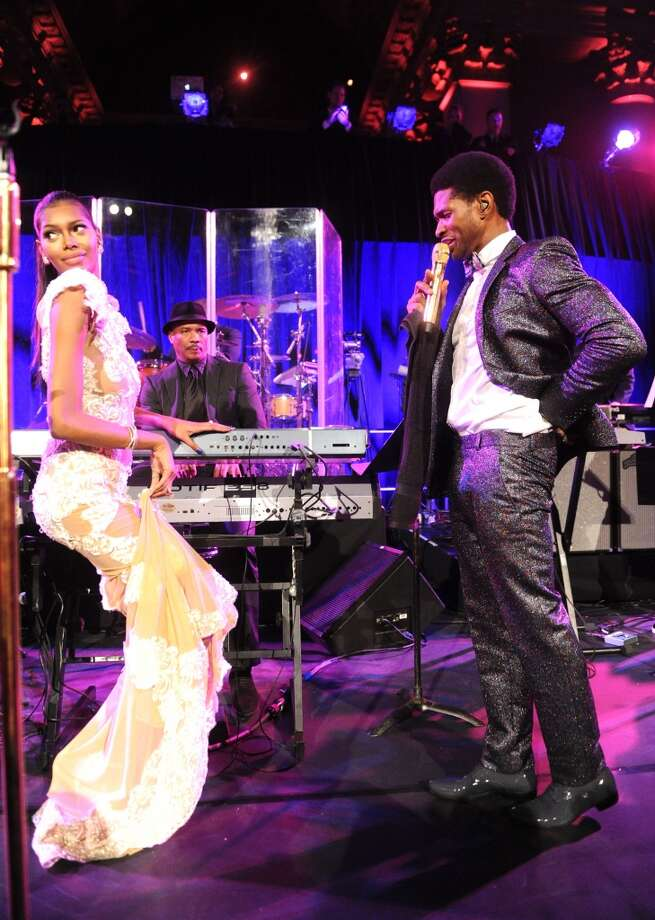Usher performs onstage with Jessica White during Gabrielle's Angel Foundation Hosts Angel Ball 2013 at Cipriani Wall Street on October 29, 2013 in New York City.  (Photo by Jamie McCarthy/Getty Images for Gabrielle's Angel Foundation) Photo: Jamie McCarthy