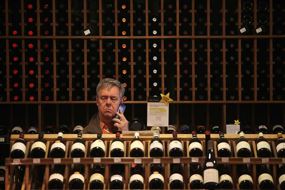 James Schwanke shops for wine at K&L Wine Merchants in the South of Market in San Francisco. Several industry analysts disputed a Morgan Stanley report that predicts a global wine shortage in coming years. Photo: Pete Kiehart, The Chronicle