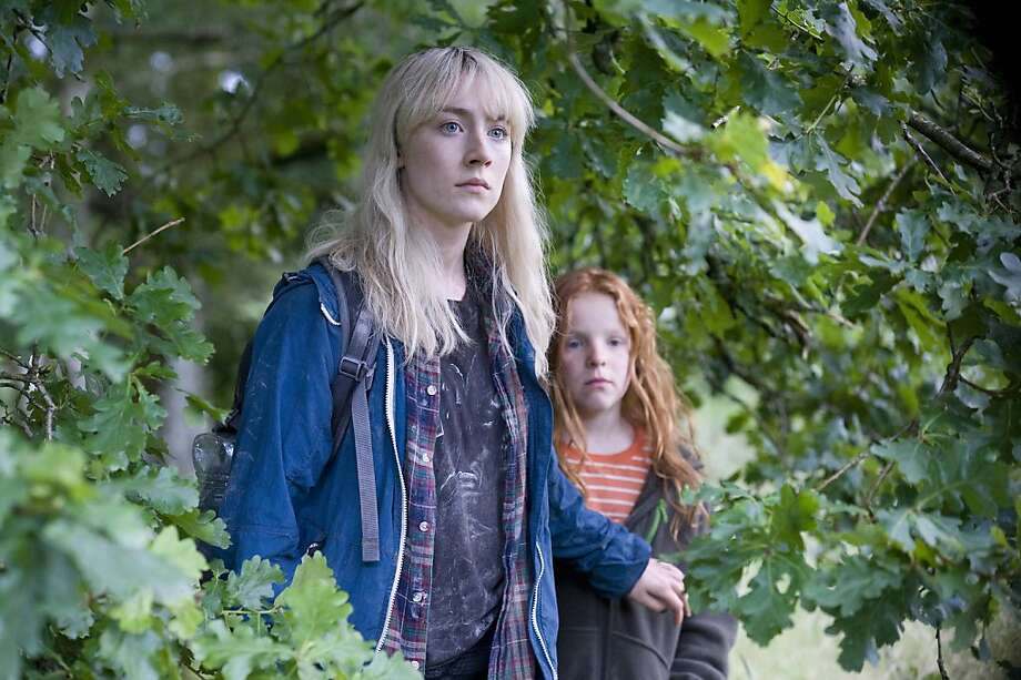 "Kevin Macdonald's drama ""How I Live Now"" features Saoirse Ronan (left), an American teenage malcontent, and 10-year-old Harley Bird in a post- apocalyptic English countryside. Photo: Magnolia Pictures"
