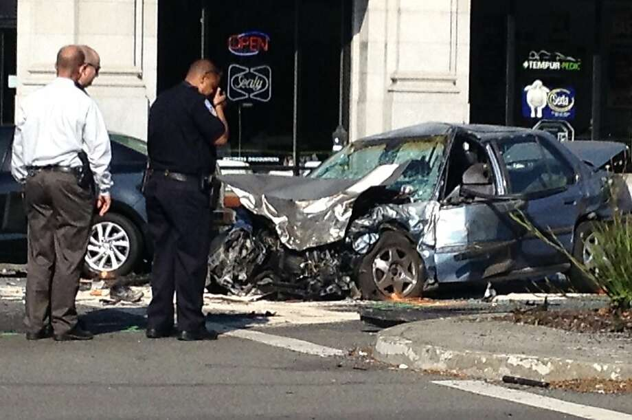 This stolen Honda Accord triggered a 4-car accident when the driver ran a red light at 10th Avenue and Geary Boulevard. Five people were injured, two seriously, in the kaleidoscope of somersaulting vehicles and flying debris that followed. Photo: Peter Fimrite, The Chronicle