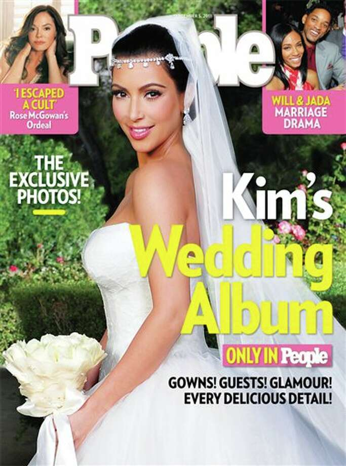 In this cover image released by People magazine, TV personality Kim Kardashian is shown in her wedding gown on the Sept. 5, 2011 issue of People. Kardashian, 30, married NBA player Kris Humphries, 26, on Saturday, Aug. 20, 2011, near Santa Barbara, Calif. (AP Photo/People) Photo: Anonymous, ASSOCIATED PRESS / AP2011