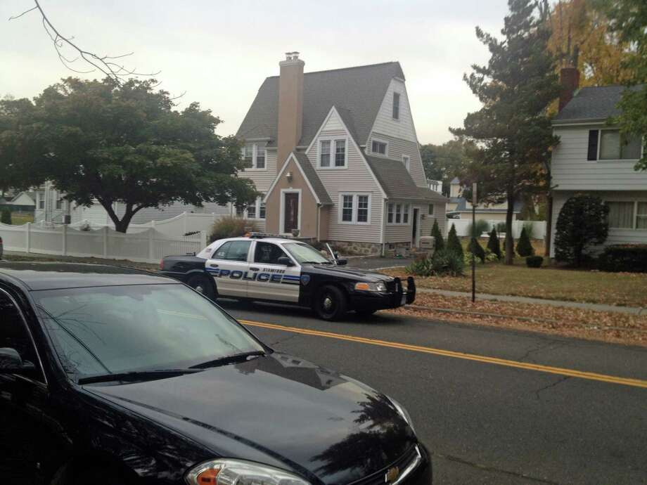 Police investigate the apparent suicide of a Stamford High School teen at his Glenbrook home Wednesday afternoon. Photo: John Nickerson / Stamford Advocate
