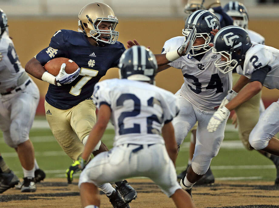 Holy Cross' Greg Scott looks for room to run in the middle of the Central Catholic defense during this year's renewal of the rivalry Aug. 29. Photo: Tom Reel / San Antonio Express-News