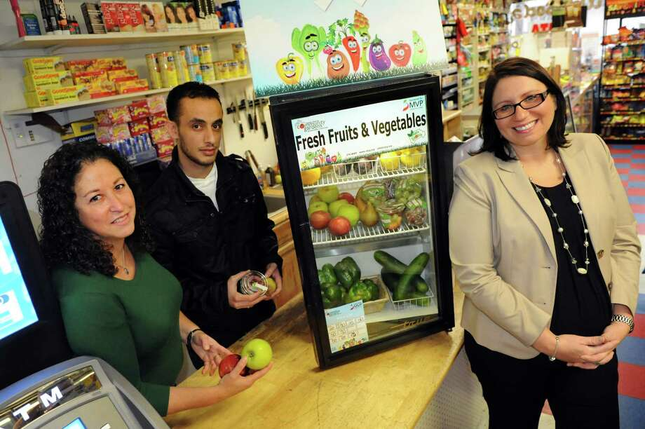 Partners in the Healthy Convenience Store Initiative pose on Wednesday, Oct. 30, 2013, at Hulett Market in Schenectady, N.Y. From left are Amy Klein, executive director of Capital District Community Gardens, store manager Ibrahim Seidi and Sarah Wiseman, manager of field and experiential marketing at MVP. (Cindy Schultz / Times Union) Photo: Cindy Schultz / 00024441A