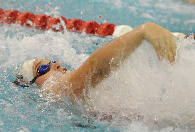 Isobel Walker of Greenwich does the backstroke during the 200 medley relay event in the FCIAC Girls Swimming Championship at Greenwich High School, Wednesday, Oct. 30, 2013. Photo: Bob Luckey / Greenwich Time