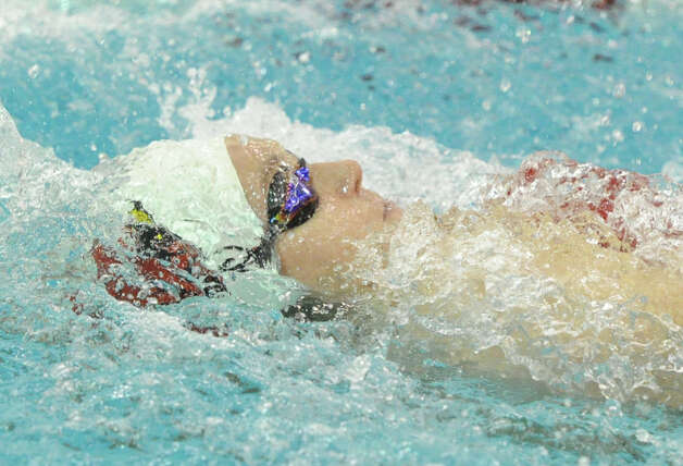 Isobel Walker of Greenwich does the backstroke during the 200 medley relay event in the FCIAC Girls Swimming Championship at Greenwich High School, Wednesday, Oct. 3