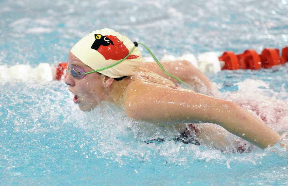 Porter Carlson of Greenwich does the butterfly during the 200 medley relay event in the FCIAC Girls Swimming Championship at Greenwich High School, Wednesday, Oct. 30, 2013. Photo: Bob Luckey / Greenwich Time