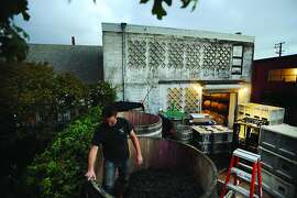 Chris Brockway of Broc Cellars stomps grapes in the backyard of his winery in Berkeley. photo: Erik Castro © 2013 all rights reserved.