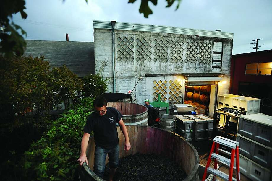 "Chris Brockway of Broc Cellars stomps grapes in the backyard of his winery in Berkeley. He is one of those profiled in the book ""The New California Wine."" Photo: Erik Castro"