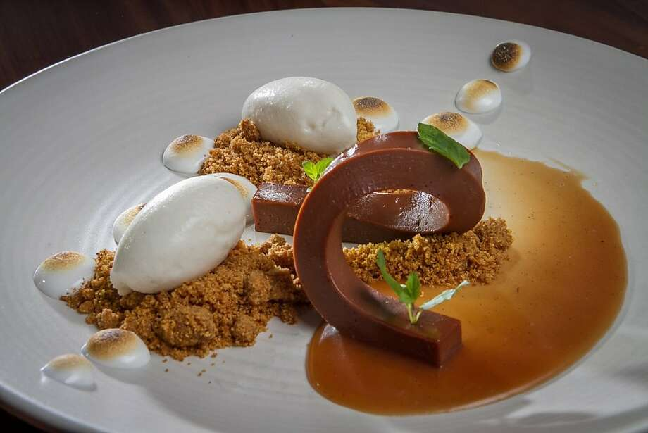 The milk chocolate ganache at 1760 has hickory ice cream and piped marshmallow stars browned with a blowtorch. Photo: John Storey, Special To The Chronicle