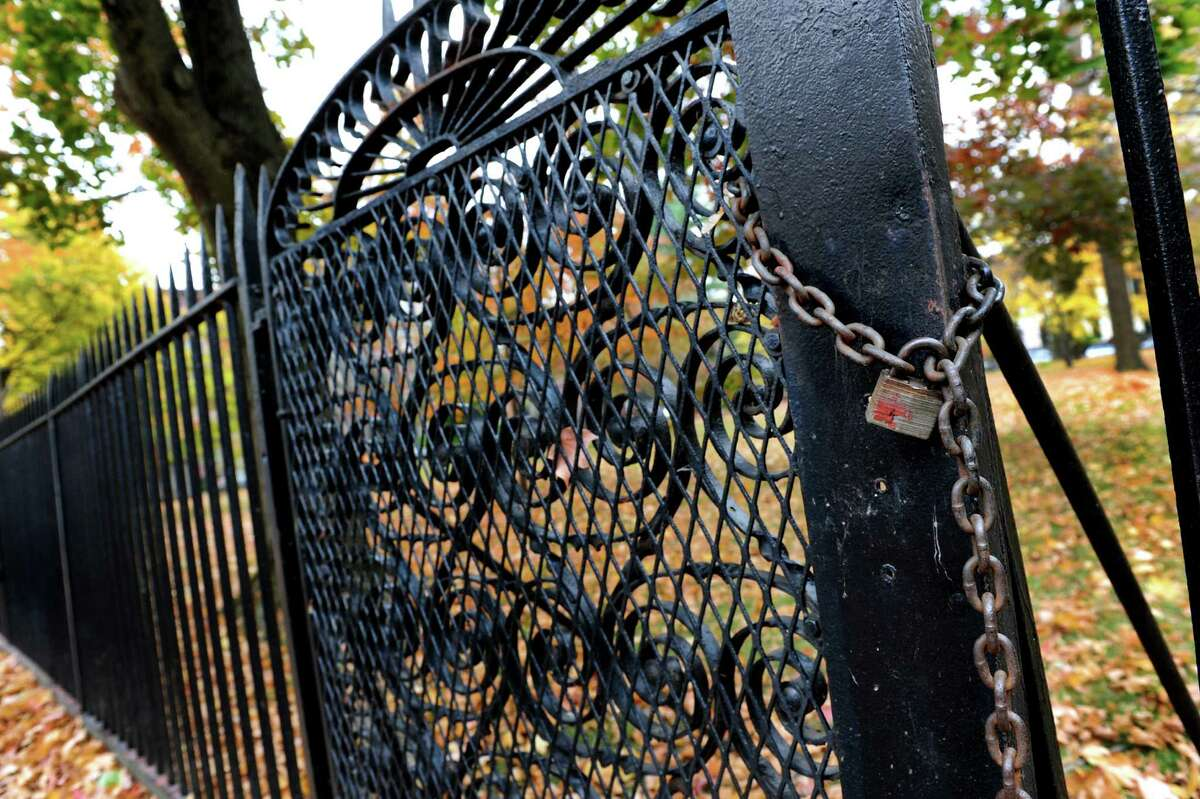 Locked gate on the wrought-iron fence surrounding Washington Park on Wednesday, Oct. 30, 2013, in Troy, N.Y. (Cindy Schultz / Times Union)