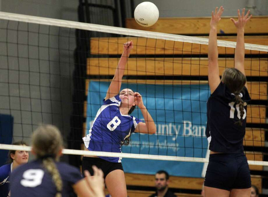 Darien High School's Nicole Schmidt fires a overhead shot over the outstreched arms of a Staples  player Mikaela O'Kelley during semifinal FCIAC volleyball championships in Fairfield on Wednesday evening. Staples won the first game 25-21. © J. Gregory Raymond for The Advocate Photo: J. Gregory Raymond / Stamford Advocate Freelance;  © J. Gregory Raymond