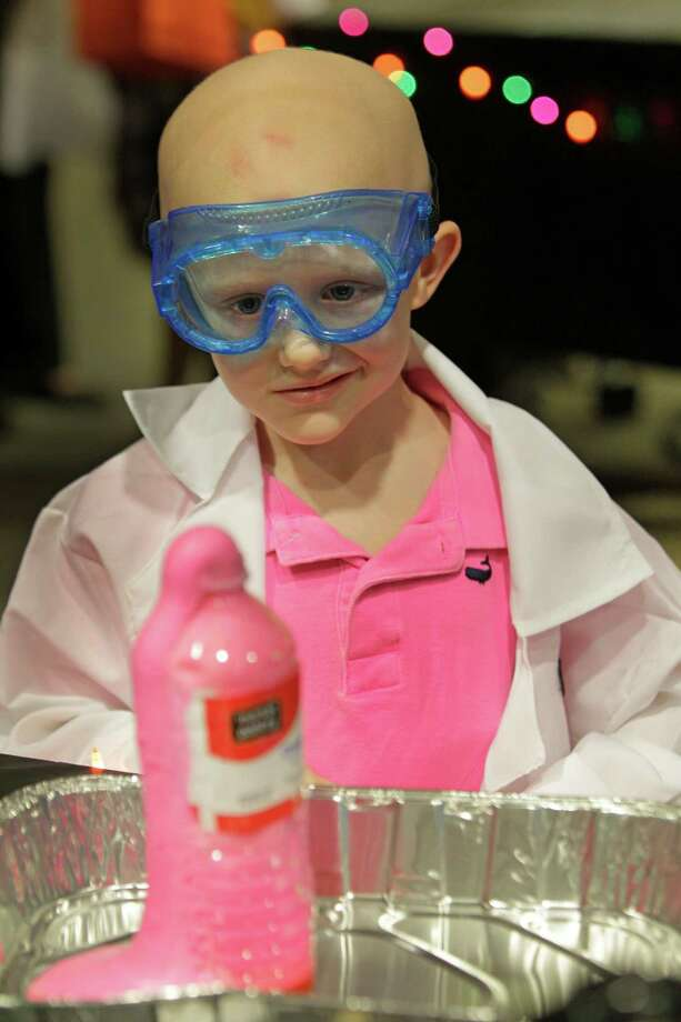 Avery Anderson, 4, of Lake Dallas watches his monster toothpaste experiment foam up from a bottle during the Mad Scientist Day at MD Anderson's Proton Therapy Center. Photo: Melissa Phillip, Houston Chronicle / © 2013  Houston Chronicle
