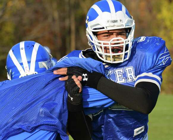 Shaker offensive and defensive lineman Nick Griffen, at right, during practice Wednesday Oct. 30, 2013, in Colonie, NY.  (John Carl D'Annibale / Times Union) Photo: John Carl D'Annibale / 00024462A