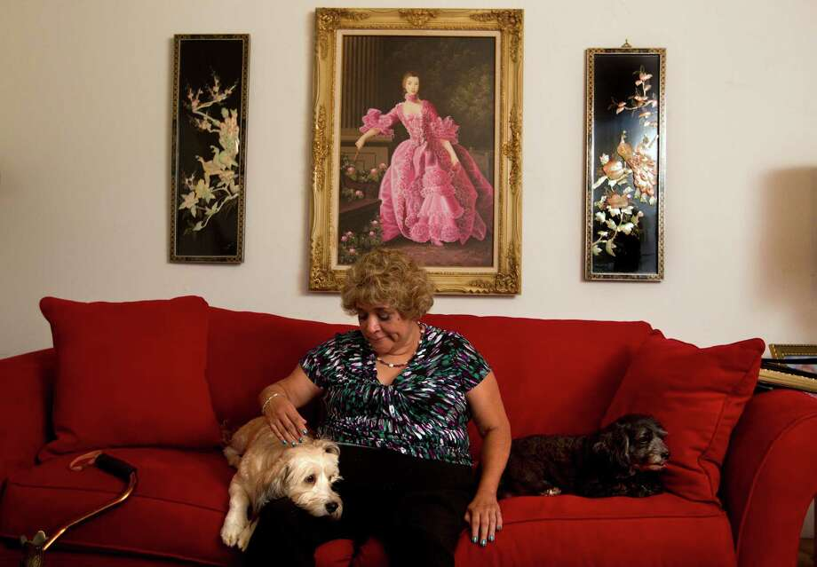 Sitting in her Houston home with her dogs, Laura Ante, 60, who has type 2 diabetes, is concerned about how she will fit into the Affordable Care Act. Ante, who is waiting to apply while the government website problems are resolved, has been unable to buy or get health insurance coverage. Photo: Johnny Hanson, Staff / Houston Chronicle