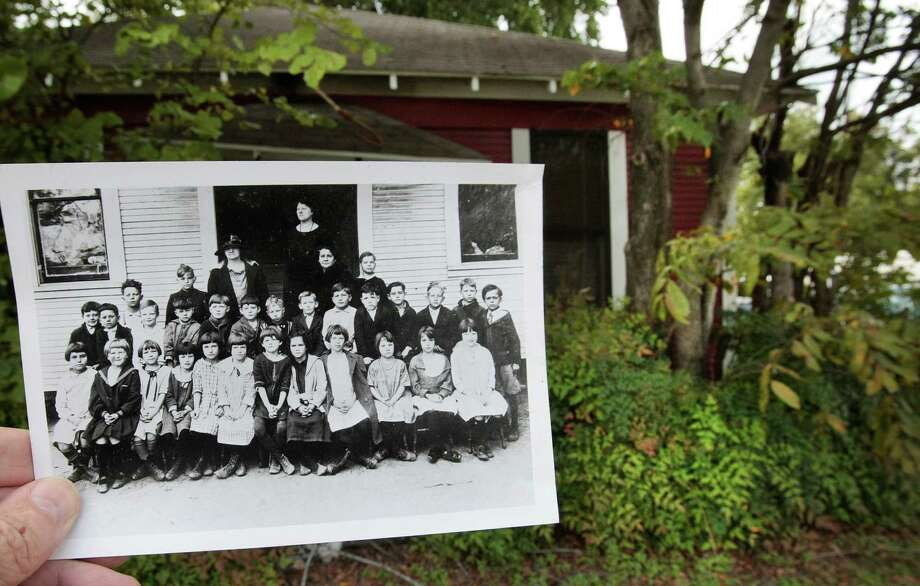 An image from 1921 shows the students and teachers in front of the old Lowell street school. The 1920's era little red school house is next to Dr. Kenneth Williams veterinary clinic at 1431 N. Shepherd in Houston, Tx. (Billy Smith II / Houston Chronicle) Photo: Billy Smith II, Staff / © 2013 Houston Chronicle