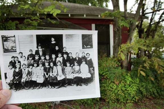 An image from 1921 shows the students and teachers in front of the old Lowell street school. The 1920's era little red school house is next to Dr. Kenneth Williams veterinary clinic at 1431 N. Shepherd in Houston, Tx. (Billy Smith II / Houston Chronicle)