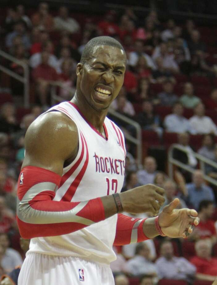 Rockets center Dwight Howard reacts after getting hit in the face against the Bobcats. Photo: James Nielsen, Houston Chronicle