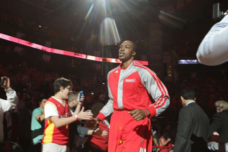 Rockets center Dwight Howard is introduced before playing the Bobcats. Photo: James Nielsen, Houston Chronicle