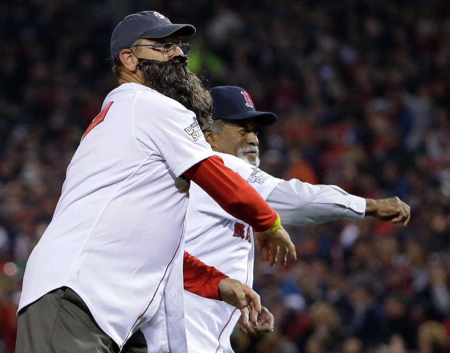 Former Boston Red Sox Hall of Famer Carlton Fisk, right, wearing a fake beard,  and three-time All-Star Luis Tiant throw out the ceremonial first pitches before Game 6 of baseball's World Series between the St. Louis Cardinals and the Boston Red Sox Wednesday, Oct. 30, 2013, in Boston. (AP Photo/Matt Slocum) Photo: Matt Slocum, Associated Press / AP