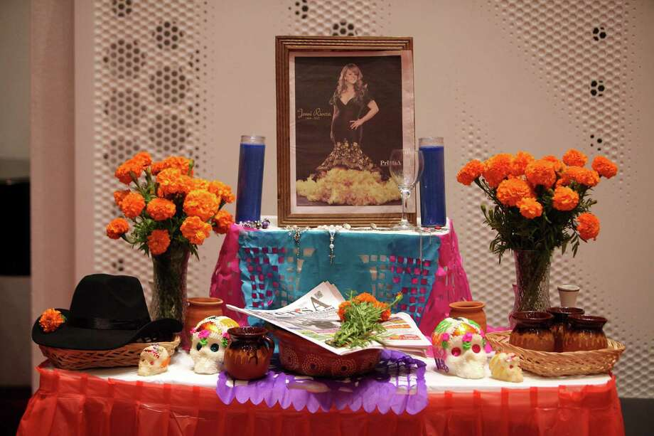 An altar was arranged by 'La Prensa' in memory of singer Jenny Rivera. Photo: Mayra Beltran, Houston Chronicle / © 2013 Houston Chronicle