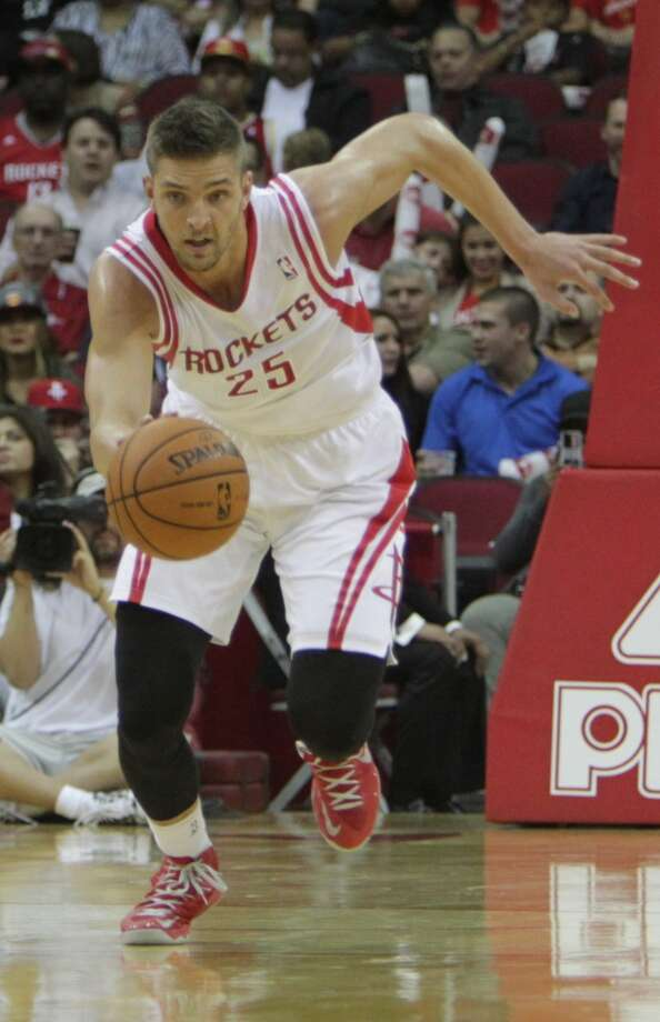 Rockets forward Chandler Parsons dribbles down the court against the Bobcats. Photo: James Nielsen, Houston Chronicle