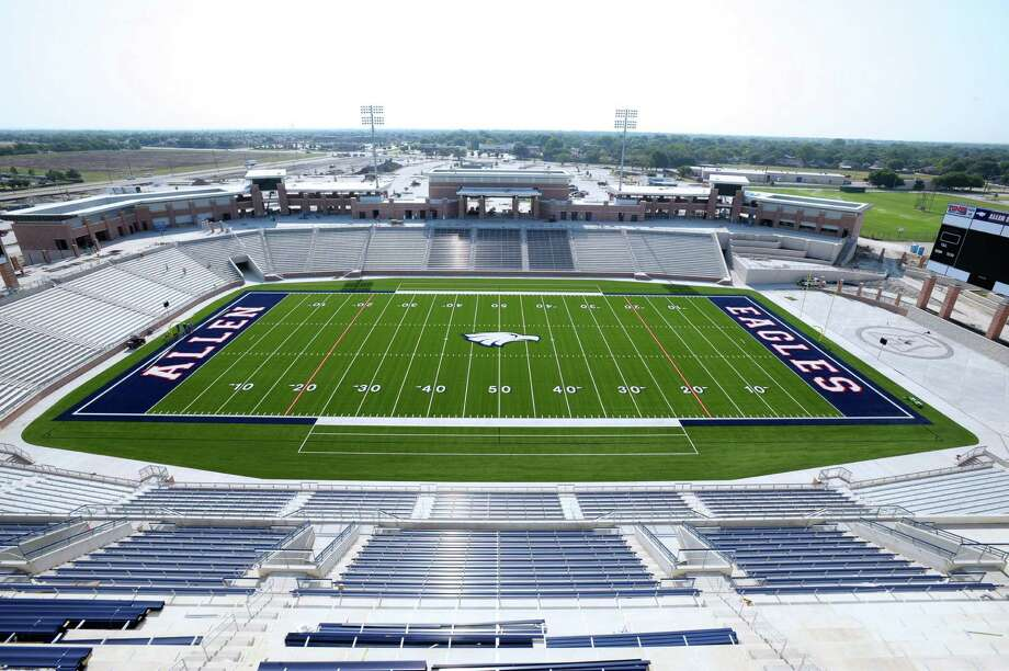 From atop the press box, crews can be seen working to put the finishing touches on the playing field and seating in the nearly completed Allen Eagle Stadium in 2012. The $59.6 million dollar, 18,000 seat project was funded from a $119 million bond package approved by voters in 2009. The stadium features a sunken-bowl design, video scoreboard, multi-level press box, weight room, wrestling room, and an indoor golf facility. The stadium officially opened on Friday August 31, 2012 Photo: Michael Prengler, FRE / AP2012