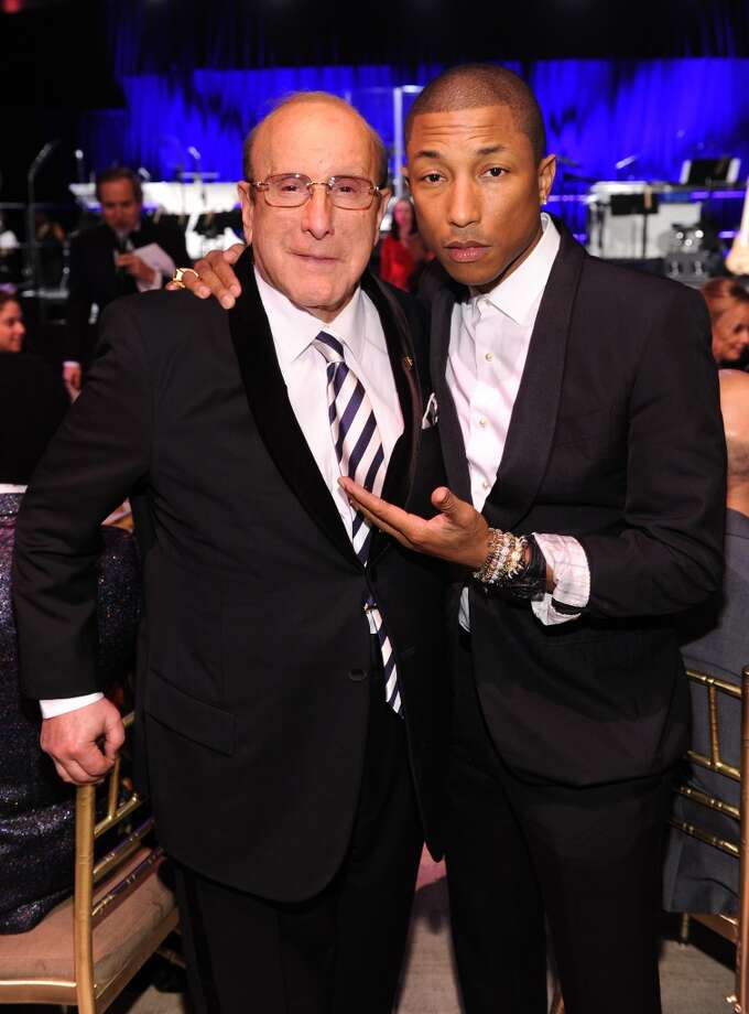 Clive Davis and Pharrell Williams attend Gabrielle's Angel Foundation Hosts Angel Ball 2013 at Cipriani Wall Street on October 29, 2013 in New York City.  (Photo by Dimitrios Kambouris/Getty Images for Gabrielle's Angel Foundation) Photo: Dimitrios Kambouris