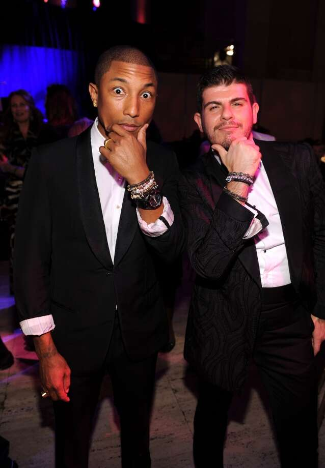 Pharrell Williams (L) and Eli Mizrahi attend Gabrielle's Angel Foundation Hosts Angel Ball 2013 at Cipriani Wall Street on October 29, 2013 in New York City.  (Photo by Dimitrios Kambouris/Getty Images for Gabrielle's Angel Foundation) Photo: Dimitrios Kambouris