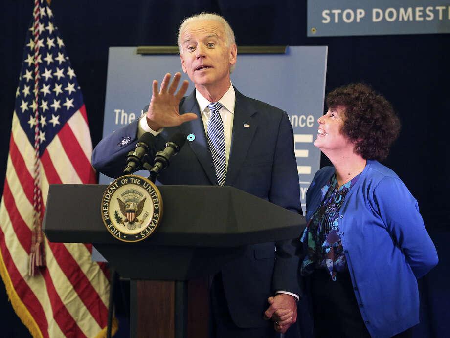 In Austin, Joe Biden introduces Lynn Rosenthal, the White House's adviser on violence against women, at the National Domestic Hotline office. Photo: Tom Reel / San Antonio Express-News