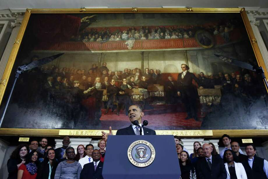 President Barack Obama speaks Wednesday at Boston's historic Faneuil Hall about the federal health care law. For the first time, the president acknowledged that some Americans will have to switch health plans under the law. Photo: Charles Dharapak / Associated Press