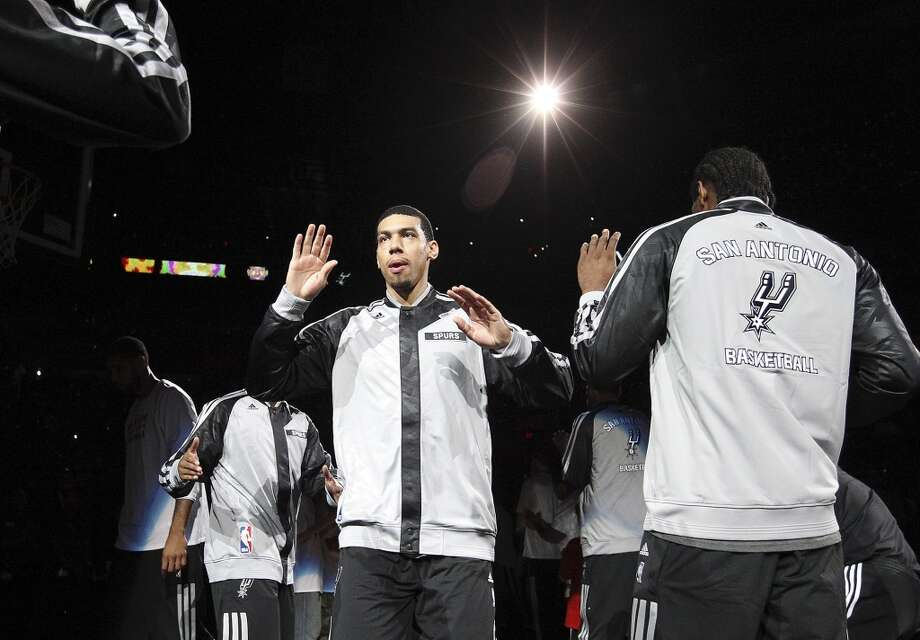 Spurs' Danny Green (04) gets introduced before the game against the Memphis Grizzlies at the home opener at the AT&T Center on Wednesday, Oct. 30, 2013. (Kin Man Hui/San Antonio Express-News) Photo: San Antonio Express-News