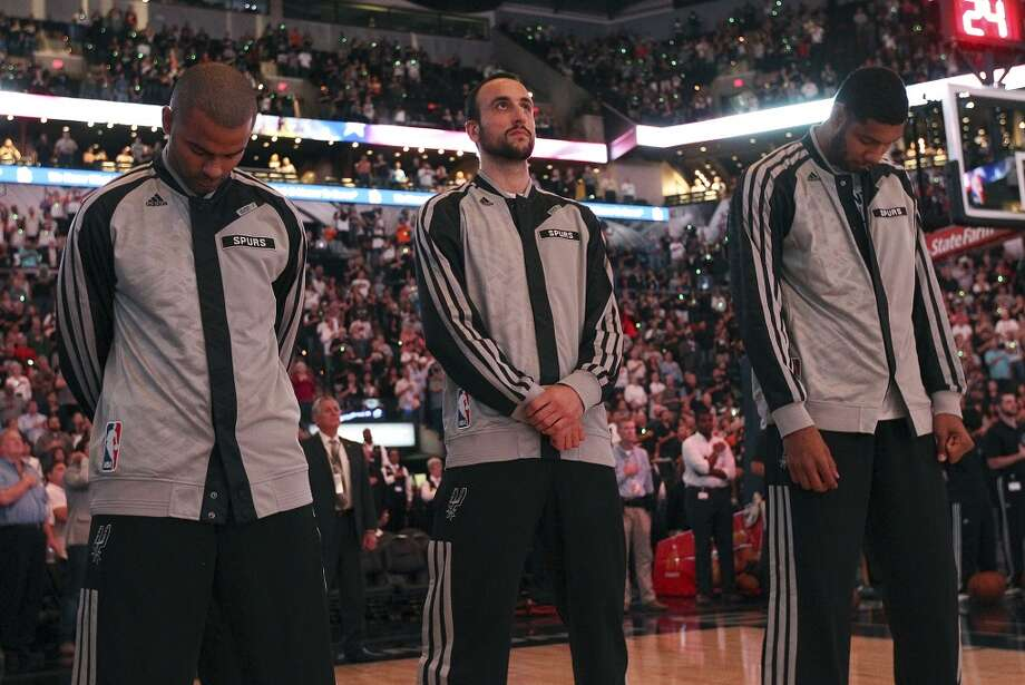 Spurs' Tony Parker (from left), Manu Ginobili and Tim Duncan stand during the National Anthem before the game against the Memphis Grizzlies at the home opener at the AT&T Center on Wednesday, Oct. 30, 2013. (Kin Man Hui/San Antonio Express-News) Photo: San Antonio Express-News