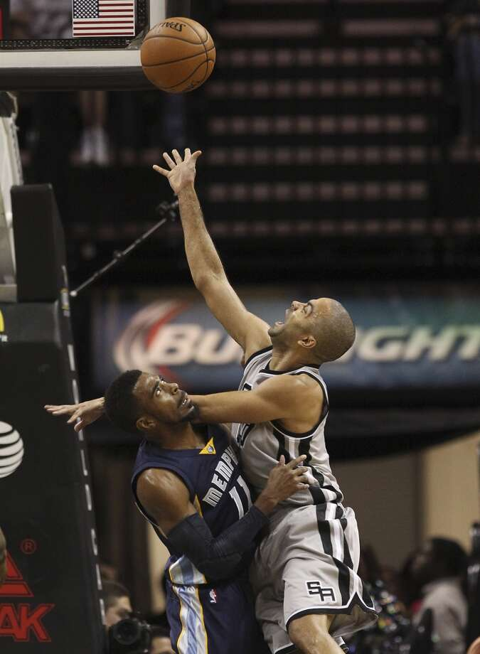 Spurs' Tony Parker (09) attempts a layup against Memphis Grizzlies' Mike Conley (11) at the home opener at the AT&T Center on Wednesday, Oct. 30, 2013. (Kin Man Hui/San Antonio Express-News) Photo: San Antonio Express-News