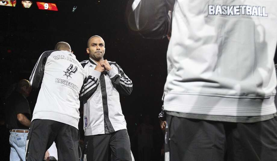 Spurs' Tony Parker (09) gets introduced before the game against the Memphis Grizzlies at the home opener at the AT&T Center on Wednesday, Oct. 30, 2013. (Kin Man Hui/San Antonio Express-News) Photo: San Antonio Express-News