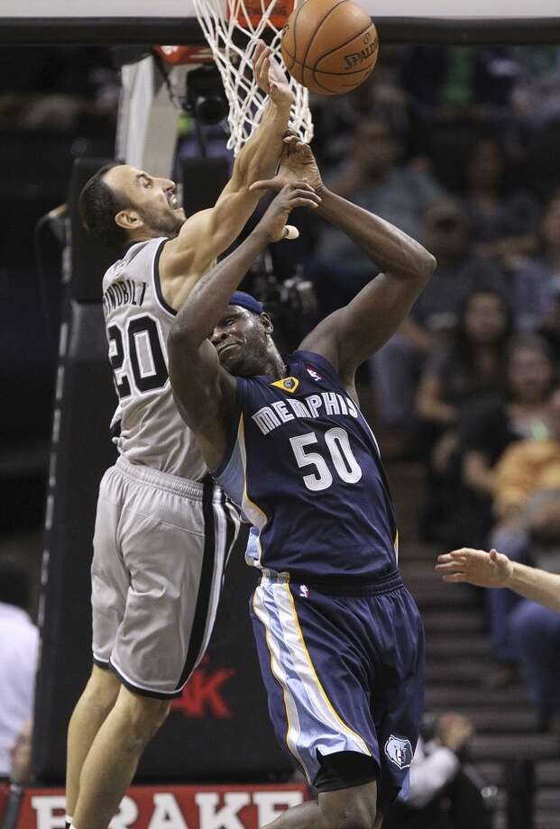 San Antonio Spurs' Manu Ginobili blocks an Alley-oop attempt to Memphis Grizzlies' Zach Randolph during the first half at the AT&T Center, Wednesday, Oct. 30, 2013. Photo: San Antonio Express-News
