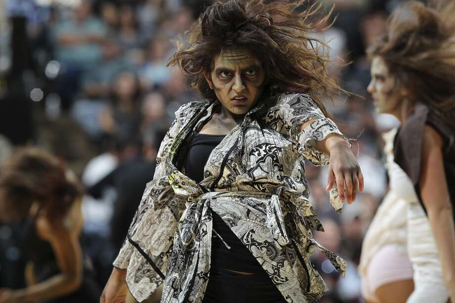 The San Antonio Spurs Silver Dancers dress as zombies during the second half of their season opener against the Memphis Grizzlies at the AT&T Center, Wednesday, Oct. 30, 2013. The Spurs won 101-94. Photo: San Antonio Express-News