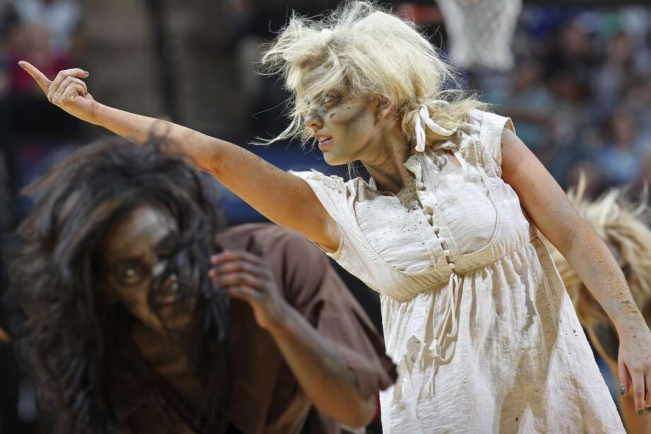 The San Antonio Spurs Silver Dancers dress as zombies during their season opener against the Memphis Grizzlies at the AT&T Center, Wednesday, Oct. 30, 2013. The Spurs beat the Memphis Grizzlies 101-94. Photo: San Antonio Express-News